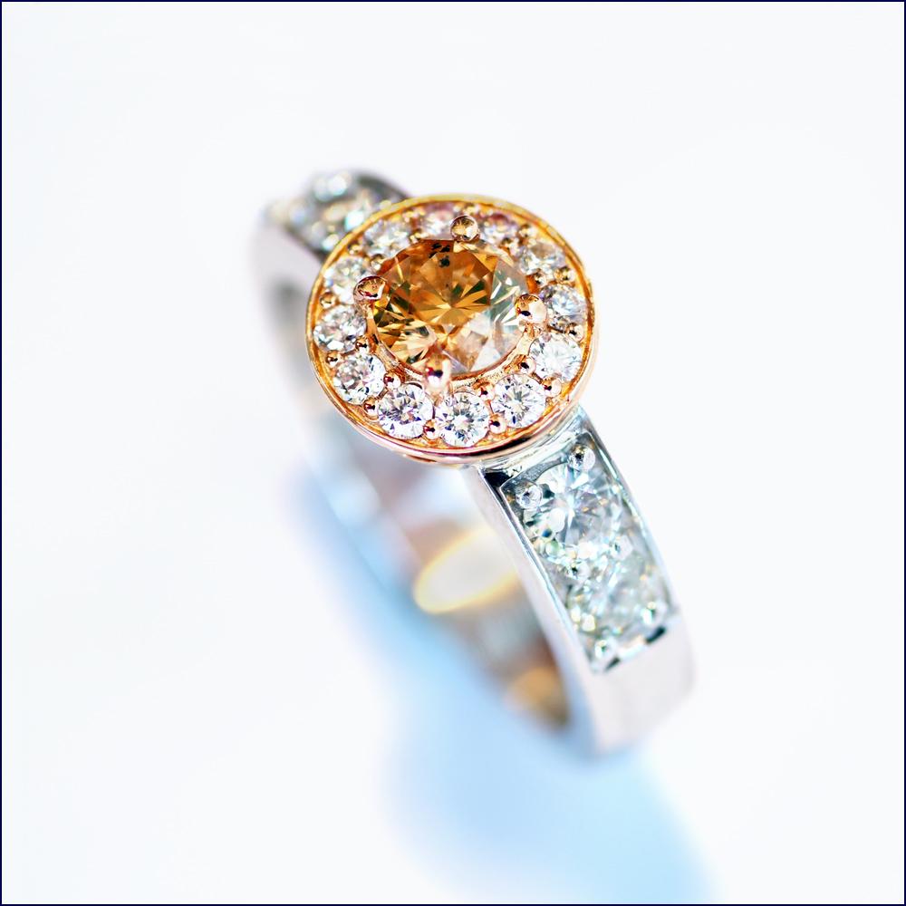 Argyle diamond with white diamonds and 18ct rose and white gold.