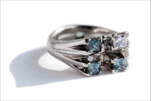 Platinum, diamond and sapphire engagement ring based on constellation Delphinus.