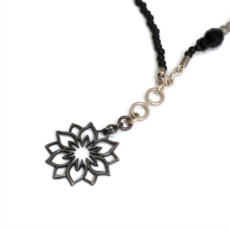 Detail of Black Lotus pendant